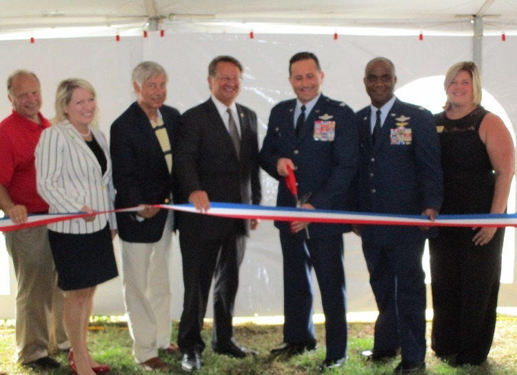 Elected and Air National Guard officials snip the ribbon in a tent erected outside the facility  sc 1 st  WKZO & VIDEO: BCu0027s newest job site is top secret | News | WKZO