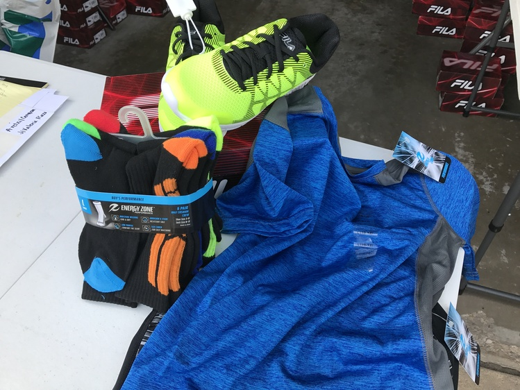 The running gear package selected kids in the Running for Kids program will  receive. ( b854b768bc4a