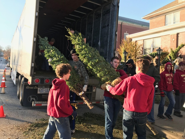 scouts from troop 399 unload christmas trees on evansvilles west side source jay - Boy Scout Christmas Trees