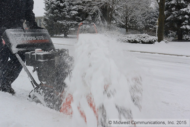 Snowblower clearing snow